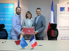 Chief of UNRWA Donor Relations Division Mr. Marc Lassouaoui, UNRWA Director of Education Caroline Pontefract and H.E the French Ambassador to Jordan Mr. David Bertolotti pictured during the official signing ceremony of France's contribution to UNRWA. © 2019 UNRWA photo by Dania Al-Batayneh.