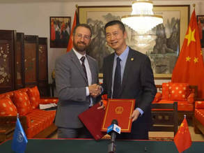 Mr. Marc Lassouaoui, Chief of Donor Relations, UNRWA Department of External Relations and Communications signs the contribution agreement with His Excellency Ambassador of People's Republic of China to the Palestinian National Authority, Guo Wei. ©  Office of People's Republic of China to Ramallah, Ding Huizi.