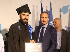 An UNRWA TVET graduate from the UNRWA Siblin Vocational Training Centre, South Campus with European Union representative Mr. Rein Nieland at the 2019 UNRWA Siblin Training Centre graduation ceremony. © 2019 UNRWA Photo by Ahmad Mahmoud.