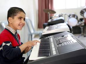 Mohammed Alwan, playing the electric piano in the music class at the UNRWA Rehabilitation Centre for the visually impaired (RCVI) in Gaza. © 2018 UNRWA Photo by Khalil Adwan.