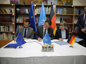 Acting EU Representative Tomas Niklasson (left), Cornelia Dinter from Germany's KfW Development Bank (right) and Acting UNRWA Commissioner-General Christian Saunders (center)  signed additional contribution agreements for UNRWA at a signing ceremony in the UNRWA Preparatory Girls' School in Silwan in East Jerusalem on 11 December 2019,  with the Deputy German Representative, Michael Herold, looking on. © 2019 UNRWA Photo by Marwan Baghdadi
