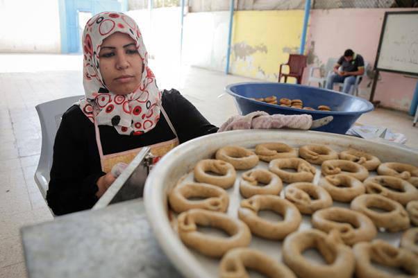 Thirty–year-old Mervat Aloosh baking ka'ak in Beach Women's Programme Centre in Beach camp, western Gaza Strip. Photo credit: ©UNRWA Gaza 2017. Photo by Tamer Hamam.