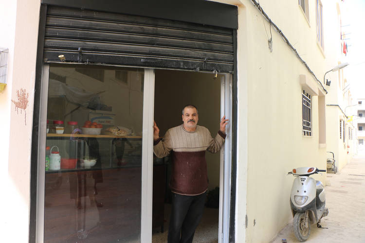 Mahmoud Hamoudeh in front of his Falafel shop in Nahr el-Bared camp, Lebanon. © 2017 UNRWA Photo by Maysoun Mustafa