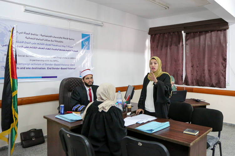 A moot court about child custody as part of a series of activities marking the annual 16 Days of Activism against Gender-Based Violence Campaign at the Nuseirat Women Programme Centre. © 2017 UNRWA Photo by Tamer Hamam