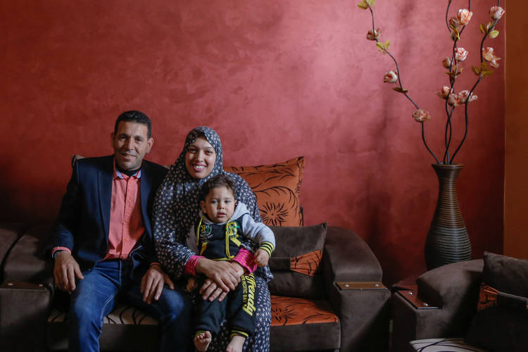 Bzazo family in Al-Tofah neighborhood, east of Gaza, in their newly repaired house which was severely damaged during the 2014 conflict in Gaza. © 2017 UNRWA Photo by Tamer Hamam.
