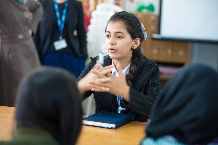 Reem speaks with the UNRWA Jalazone Girls School Parliament team.  © 2017 UNRWA Photo by Yahia Masswadeh