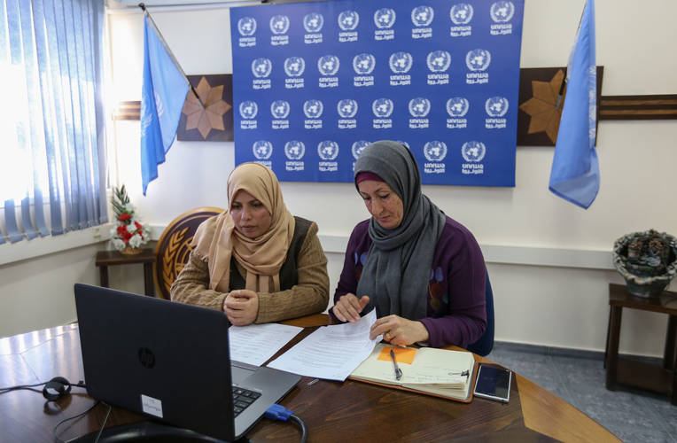 UNRWA beneficiary Heyam Al Louh (left) and Najwa Al Sheikh-Ahmed, UNRWA Acting Public Information Officer (right) participate through Skype in the launch of the oPt Emergency Appeal for 2017. © 2017 UNRWA Photo by Rushdi Al Sarraj