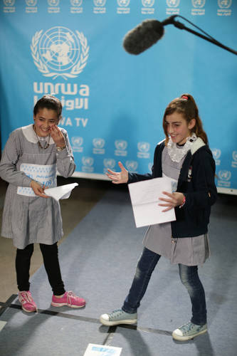 Eleven-year-old Yara Deeb (left) and 12- year old Menna Al-Khour (right) perform a play during the casting auditions in the UNRWA TV studio at the Gaza Field Office. © 2017 UNRWA Photo by Hussain Jaber