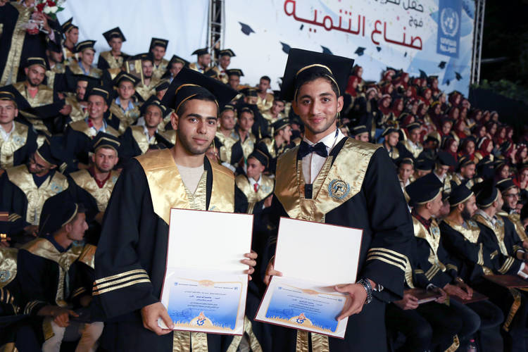 Mohammed Al Tartori and Asem Abu Abdu after receiving their diplomas. © 2017 UNRWA Photo by Tamer Hamam