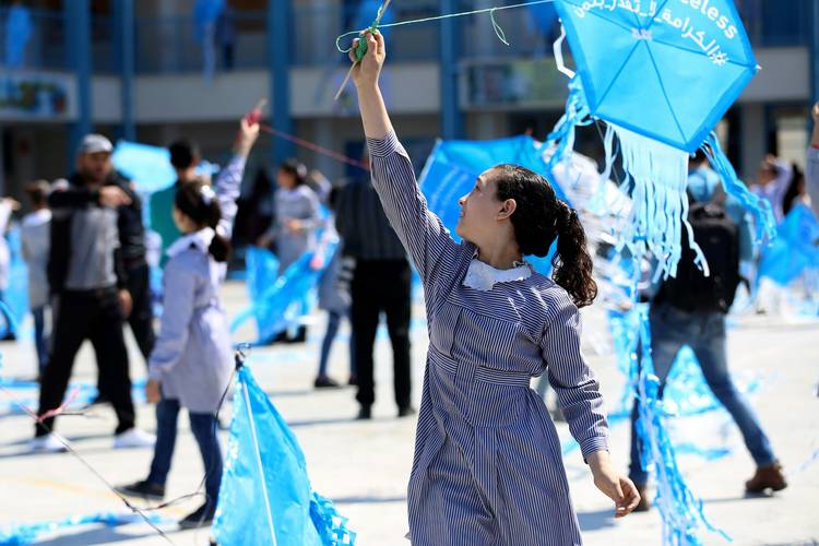 "Students flying kites at the UNRWA Al-Rimal Preparatory Girls Co-ed School ""B"". © 2018 UNRWA Photo by Khalil Adwan."