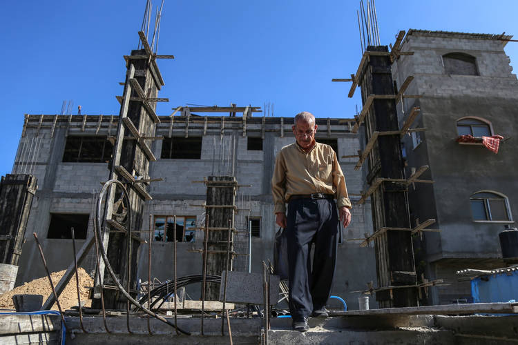 Palestine refugee Mohammad Saleh is checking the reconstruction of his home in Jabalia camp, northern Gaza. © 2016 UNRWA Photo by Mohmmed al-Hinnawi