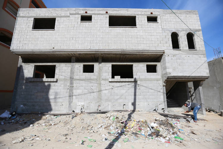 Twenty-four-year-old Mohammad Ali in front of his mother Niema Ali's (who requested not to be photographed) unfinished house in Shujaiya in eastern Gaza. © 2016  UNRWA Photo by Rushdi al-Sarraj