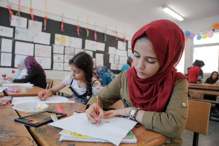 Fifteen-year-old, Bara'a Abu Nada, a Palestine refugee girl, participates in a drawing activity during Summer Fun Weeks (SFWs) in the UNRWA Beit Lahia Preparatory Girls (A) School, northern Gaza Strip. © 2017 UNRWA Gaza Photo by Tamer Hamam