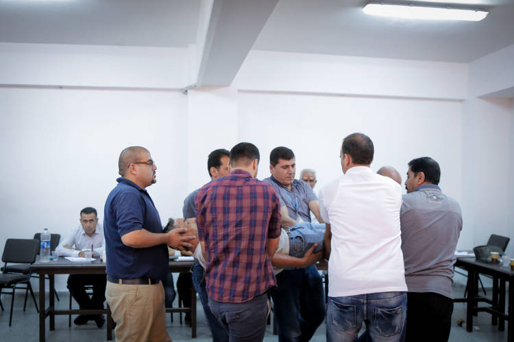 UNRWA staff members participate in first aid training, organized as part of the SSAFE training initiative in Khan Younis Training Centre in the southern Gaza Strip. © 2017 UNRWA Photo by Tamer Hamam