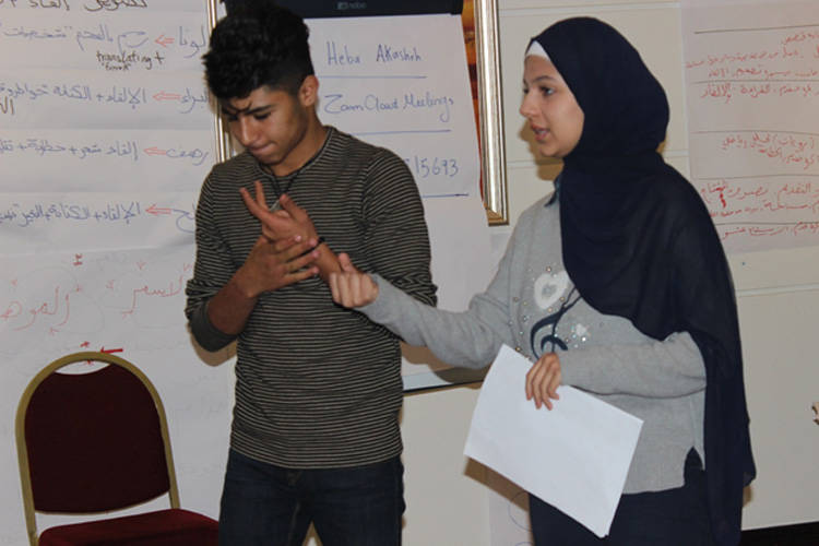 Dala presents to her peers at a meeting of the UNRWA Agency-wide Student Parliament. © 2019 UNRWA Photo by Heba Al-Akasheh