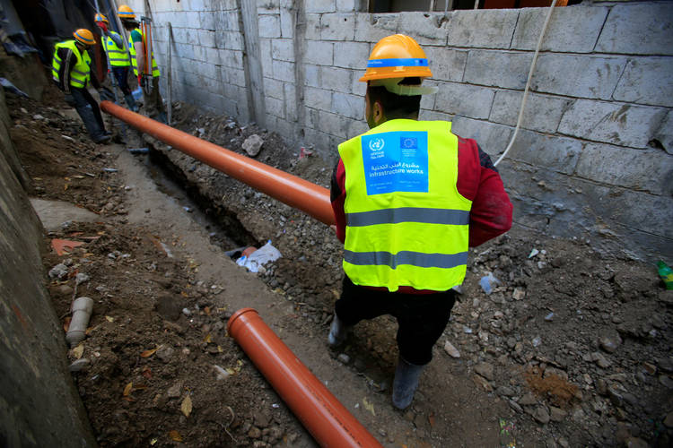 UNRWA staff work to improve infrastructure in Ein El Hilweh camp, Lebanon. © 2016 UNRWA Photo by Ali Hashisho
