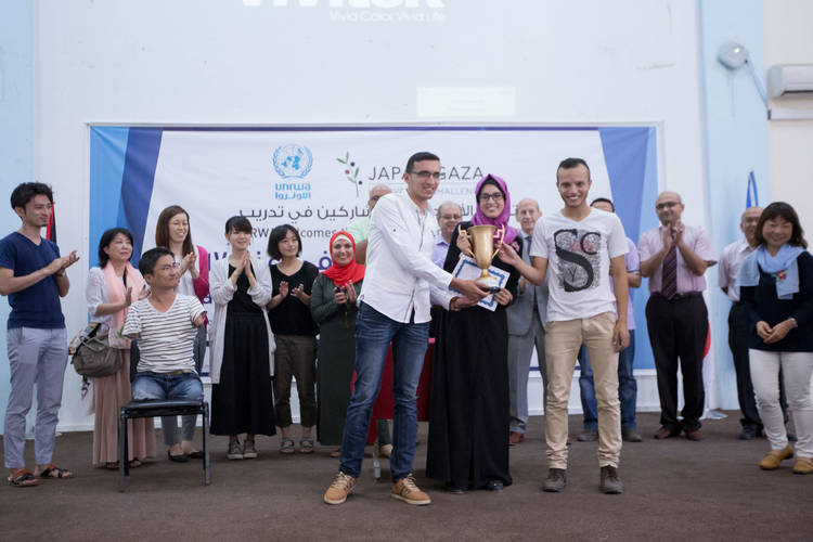 The winning team of the Gaza Entrepreneurship Challenge hold the prize cup at the end of the final ceremony held at the Gaza Training Centre. © 2017 UNRWA Photo by Tamer Hamam