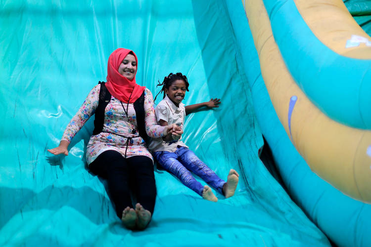 Twenty-eight-year-old Ayat al-Sawada, who worked as an animator for this year's Summer Fun Weeks activities in Gaza, with one of the participating children. © 2017 UNRWA Photo by Rushdi al-Sarraj
