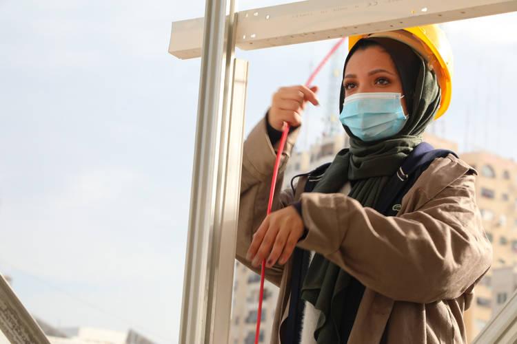 UNRWA student, Ghada Kerryam, practicing installation and maintenance of photovoltaic systems at UNRWA Gaza Training Centre (GTC) ©Photo credit 2020 UNRWA Photo by Khalil Adwan.
