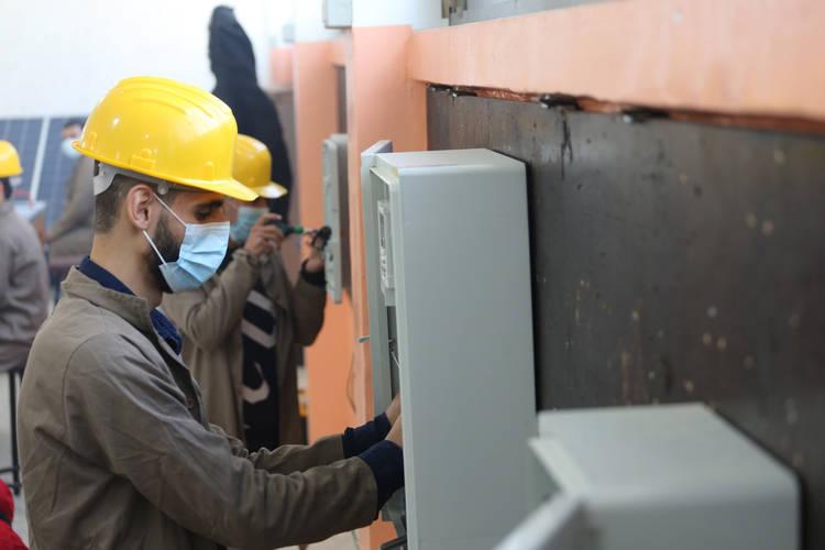 UNRWA student, Omar Al Shawa, practicing installation and maintenance of photovoltaic systems at UNRWA Gaza Training Centre (GTC) ©Photo credit 2020 UNRWA Photo by Khalil Adwan.