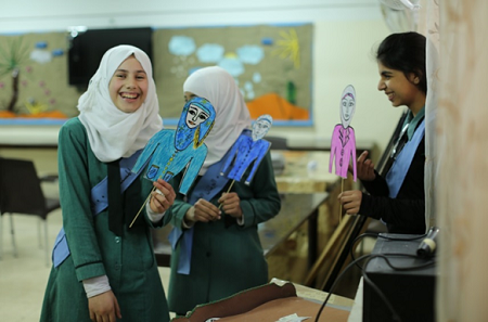Picture: PRS students preparing a puppet show, February 2014, UNRWA Amir Hasan Girls School #1