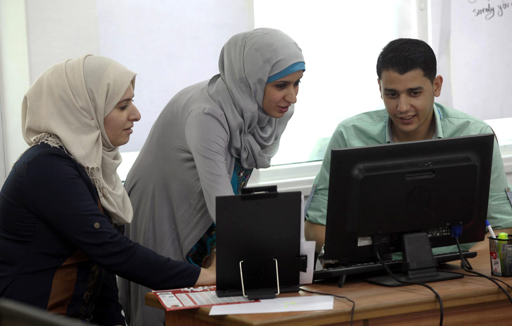 'I wanted to increase the quality of UNRWA services and have an impact on the lives of Palestine refugees,' said Rasha about her involvement with PAS. 'Information technology (IT) has no borders and there is no need to travel. All of the necessary skills can be acquired here in Gaza.' © 2015 UNRWA Photo by Khalil Adwan