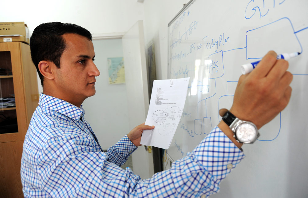 'The UNRWA IT Centre transfers knowledge to all the departments here at the Gaza Field Office. We have many innovative ideas on how to improve UNRWA services,' explained Mustafa, who believed in the power of technology from an early age when he refused a scholarship for medical studies in Algeria and instead graduated in IT from the Islamic University in Gaza.  © 2015 UNRWA Photo by Khalil Adwan