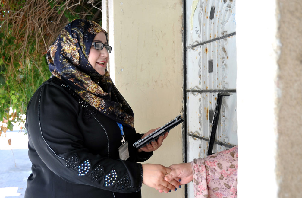 'The innovation of the PAS software is remarkable. The assessment is a lot faster and more transparent and the waiting period for beneficiaries to learn the assessment results will be much shorter, which is very important for them. It has motivated us social workers that UNRWA supports us in our work through training, technology and capacity-building; we feel empowered and valued,' commented 33-year social worker Amani Mkheimar, who has been involved in UNRWA poverty assessments for the past five years. © 2015 UNRWA Photo by Khalil Adwan