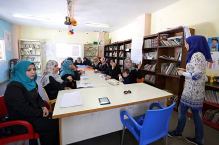 Participants of the 'Empowerment Programme for Female-Heads of Households' project during a training session in the Women Programme Centre in Nuseirat, central Gaza. They must be aged between 25 to 55 years and have a school certificate for grade 11. The requirement of age is to ensure the presence of participants who are still interested in starting businesses while the requirement of schooling addresses the need for everyone to know the basics of calculus. Each training lasts between four and five weeks, including 18 sessions in total. © 2016 UNRWA Photo by Tamer Hamam