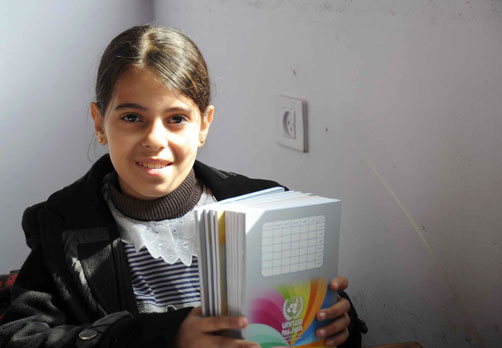 UNRWA student Waed Yasin holds new school stationery she was given on Monday.  © UNRWA Photo by Shareef Sarhan/Gaza Situation Report 79
