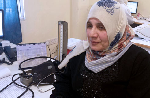 Zainab Yassin, 58, was diagnosed four years ago with diabetes. Today, with the support of the UNRWA health programme, she is able to manage her conditions through targeted medication, a healthy diet and regular exercise. © 2016 UNRWA Photo by Yassir Awad