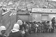 Archive photo of queue of women refugees