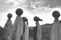 Archive photo of Bedouins carrying water
