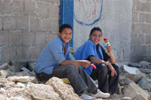 Boys eating icecream on rubble