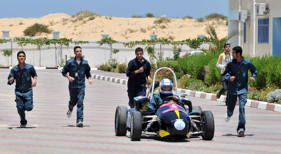 UNRWA students test drive their Formula 1-style car.