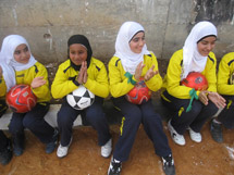 Girls enjoy the football