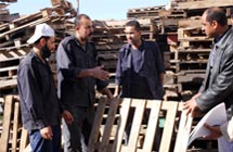 men with pallets