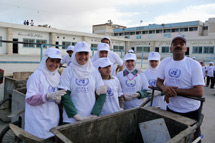 Students cleaning up UNRWA installations